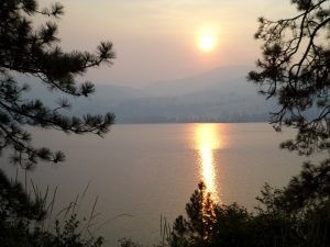 Sunset over Lake Roosevelt in the smoke of the Carlton fire